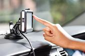 stock photo of gps navigation  - finger pointing at car GPS navigation system - JPG