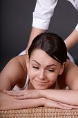 image of black woman spa  - Beautiful white girl having thai massage - JPG