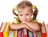 stock photo of little school girl  - Little girl holding pile of books - JPG