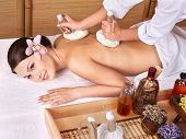 stock photo of thai massage  - Young beautiful woman on massage table in beauty spa - JPG