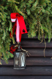 stock photo of lamp post  - Decorated lamp post outside a mountain house - JPG
