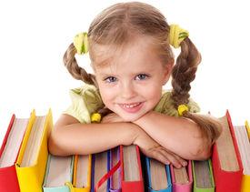 stock photo of little school girl  - Little girl holding pile of books - JPG