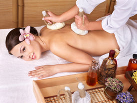 foto of thai massage  - Young beautiful woman on massage table in beauty spa - JPG