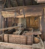 pic of wine-press  - detail of a historic wooden wine press seen in Alsace  - JPG