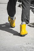 Fisherman Is Walking In The Ports Inyellow Wellington Boots, Gum Boots Ampng Ropes On A Sumer Day In poster