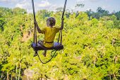 Young Boy Swinging In The Jungle Rainforest Of Bali Island, Indonesia. Swing In The Tropics. Swings  poster