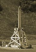 stock photo of trebuchet  - Trebuchet an ancient weapon of war for launching rocks at castle battlements - JPG
