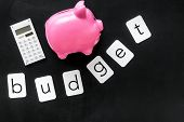 Moneybox In Shape Of Pig, Word Budget And Calculator On Black Background Top View Copyspace poster