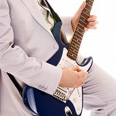 foto of stratocaster  - man in white suit playing guitar - JPG