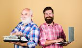 Old Generation. Bearded Men. Vintage Typewriter. Father And Son. Family Generation. Retro Typewriter poster