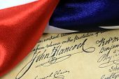 picture of preamble  - Constitution of the United States and American Flag, We The People... ** Note: Shallow depth of field - JPG