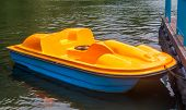 Yellow Catamaran In The Form Of A Pedal Boat Moored To The Pier poster