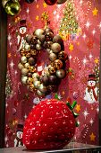 Showcase With Decorative Objects, Large Red Strawberry And Garland With Decorative Balls. Christmas  poster