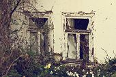 The Facade Of A Very Old House. Abandoned House. Old Windows. Old Building With Very Weathered Plast poster