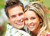 stock photo of love couple  - Young happy beautiful smiling couple in love - JPG