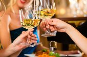 stock photo of dinner invitation  - Good friends for dinner or lunch in a fine restaurant - JPG