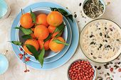 stock photo of clementine-orange  - Ripe clementines on the blue pastel plate close up - JPG