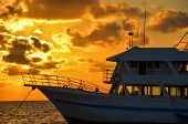 Boat And Golden Sunrise