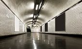 stock photo of underpass  - Old underground tunnel illuminated with neon - JPG
