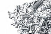 foto of bolt  - Assorted nuts and bolts closeup - JPG