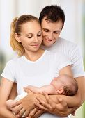 picture of daddy  - happy young family of mother father and newborn baby in their arms to embrace - JPG