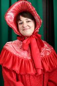 foto of edwardian  - Woman is posing in a red historical clothing - JPG
