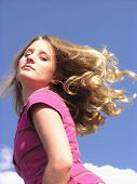 image of titillation  - teen with hair flying and a sassy look - JPG