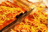 foto of pasilla chili  - Homemade enchiladas ready to go in the oven made with cheddar cheese corn tortillas and pasilla chili enchilada sauce - JPG