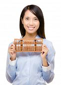 Asian woman and abacus