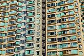 foto of overpopulation  - Overpopulated building in city - JPG