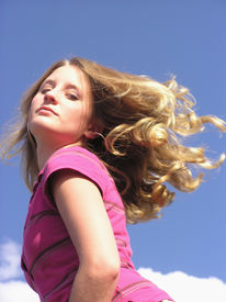pic of titillation  - teen with hair flying and a sassy look - JPG