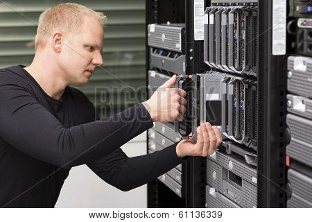 IT Consultant install a new Blade Server poster