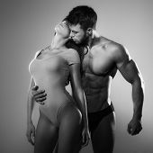 image of slim model  - Passionate couple of lovers in the studio - JPG