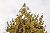 foto of apex  - Golden gable apex in Wat Rong Khun Thailand White Temple Chiang Rai Province - JPG