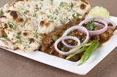 stock photo of punjabi  - A popular Punjabi preparation of chick peas cooked in spicy tomato gravy - JPG