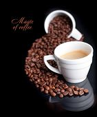 Coffee background and white cup isolated in black