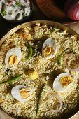 stock photo of raita  - Hyderabad egg biryani is prepared with rice egg and spices - JPG