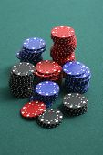 Various gambling chips on green background
