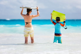 picture of boogie board  - Mother and son running towards ocean with boogie boards - JPG