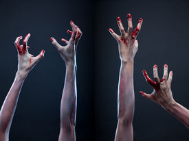 stock photo of paranormal  - Creepy set of bloody zombie hands - JPG