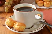 image of cream puff  - A cup of black coffee with mini cream puffs - JPG
