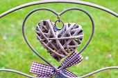 image of heartfelt  - two hearts made from metal and rattan