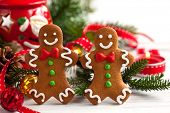 picture of gingerbread man  - Smiling gingerbread men on white wooden background - JPG