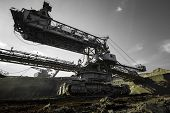 stock photo of dredge  - a huge working dredge in a mine - JPG