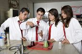 picture of conduction  - High School Students Conducting Science Experiment - JPG