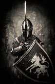 stock photo of medieval  - Medieval knight against stone wall - JPG