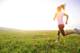 pic of japanese woman  - Runner athlete running on grass seaside - JPG