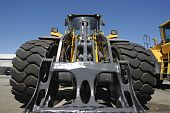 stock photo of jcb  - giant forklift and tires - JPG
