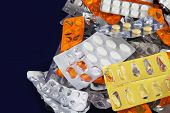 pic of blisters  - Tablets and Pills in Blister and Many Empty Pill Blister Packages - JPG