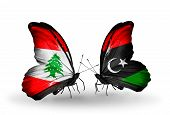 image of libya  - Two butterflies with flags on wings as symbol of relations Lebanon and Libya - JPG
